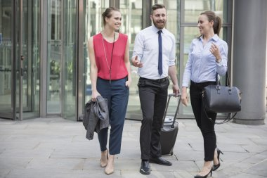 successful business people moving from hotel