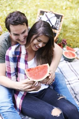 couple in love with watermelon laughing