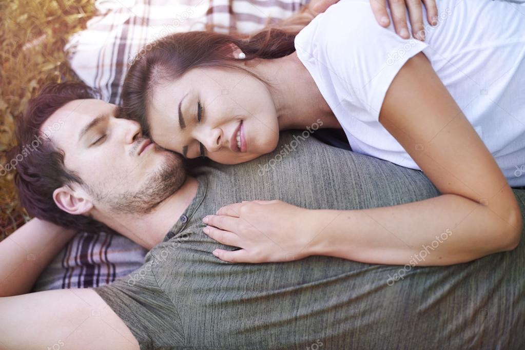 couple in love hugging in park