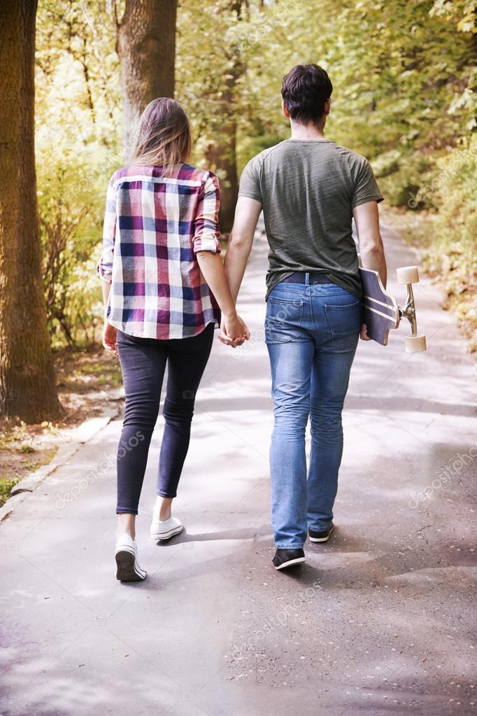 couple in love  walking in park, back view
