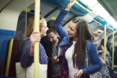 happy best friends in subway