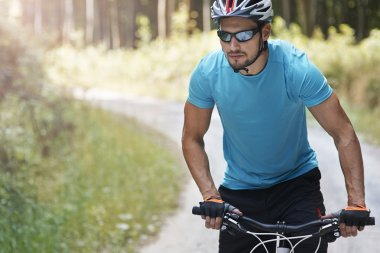 Young man on bicycle riding