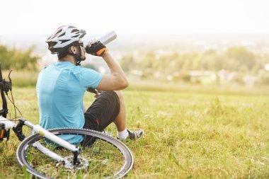 cyclist having a break from training
