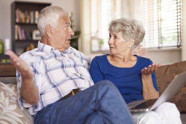 Senior couple with spreading their arms