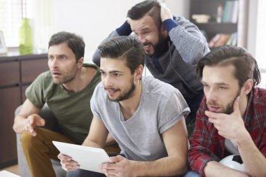 Fans watching soccer match