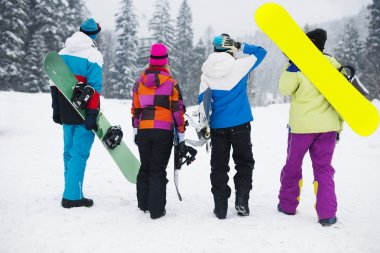 Friends ready for snowboard at ski slope