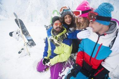 Friends snowboarding at ski slope