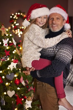 father with daughter at christmas