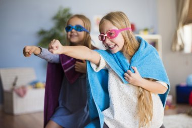 girls dreaming of becoming superheroes