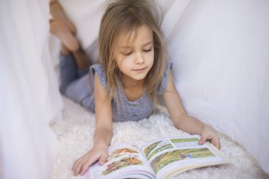 Girl reading favorite book