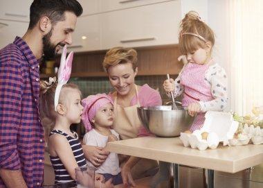 Children Preparing cookies with parents