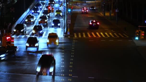 New York, USA. Night intersection with traffic lights. Many cars move in different directions