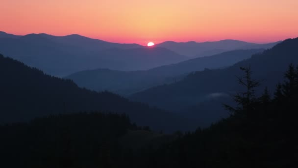 Sunrise over the Forested Mountains and Sunrays. Time Lapse