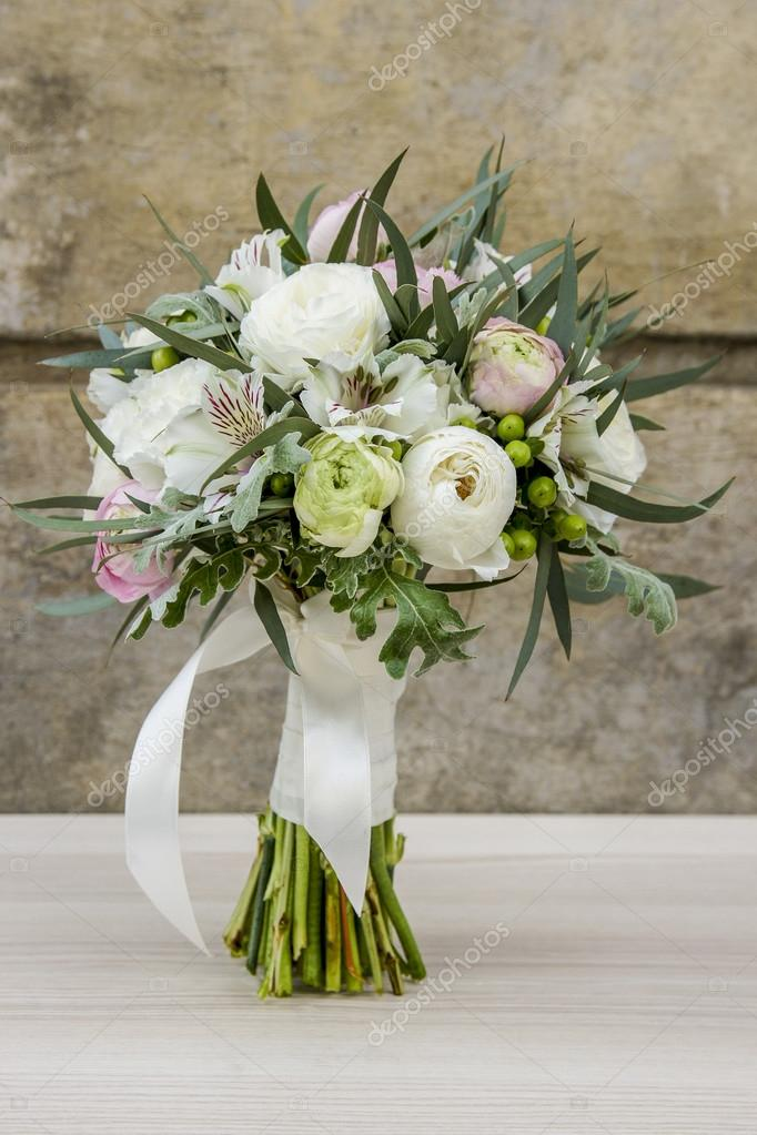 Wedding bouquet with roses, alstroemerias and ranunculus flowers ...