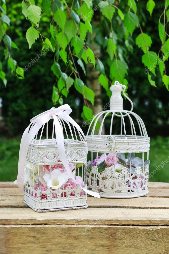 Garden party decorations Vintage bird cages with flowers inside
