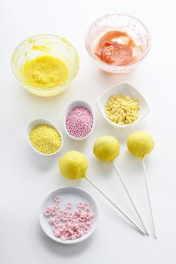 Yellow cake pops isolated on white background