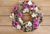 Photo Door wreath made of artificial flowers and autumn plants on wood
