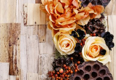 Condolences background, artificial flowers and autumn plants