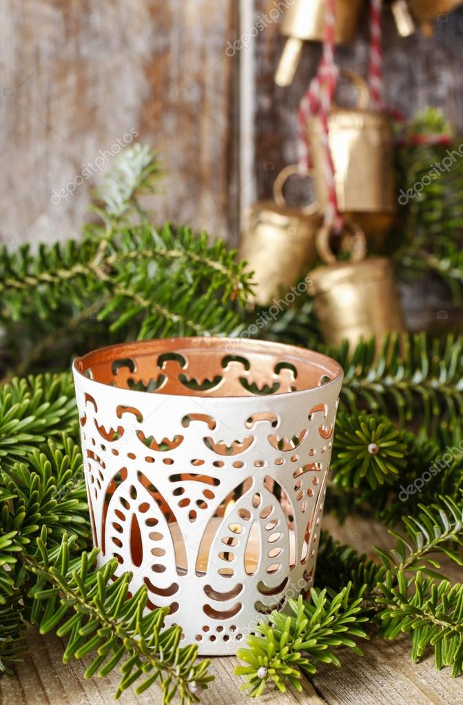White candle holder with oriental ornaments among fir branches, christmas decor — Photo by agneskantaruk