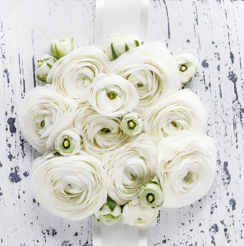 White Ranunculus Flowers On White Wooden Background Wedding Pos