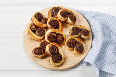 Palmier biscuits - french cookies made of puff pastry and chocol