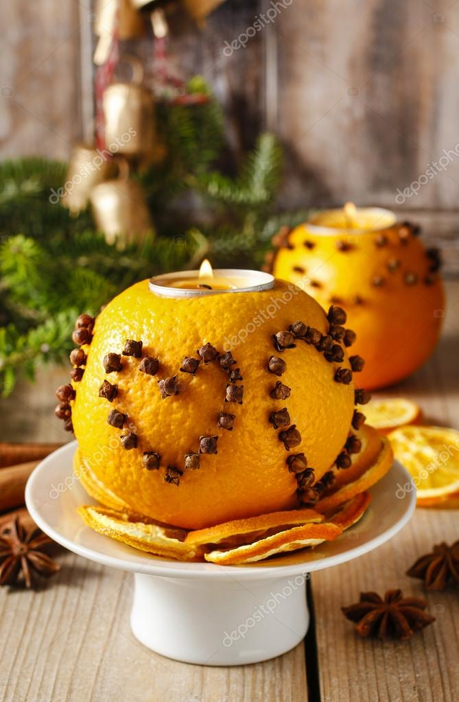 Orange pomander ball with candle