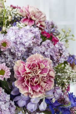 Bouquet of carnations, lilacs and chrysanthemums