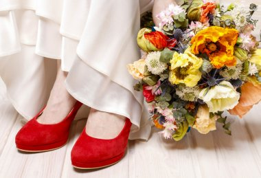 Bride in red shoes