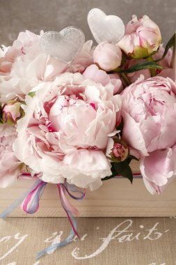 Wooden box with pink peonies