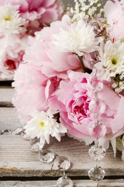 Floral arrangement with pink peonies, white chrysanthemums and g