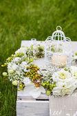 Garden party decorations: flower wreath candle in vintage birdca