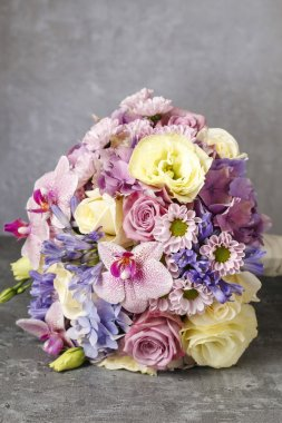 Bouquet of pink orchids, chrysanthemums and hortensias mixed wit