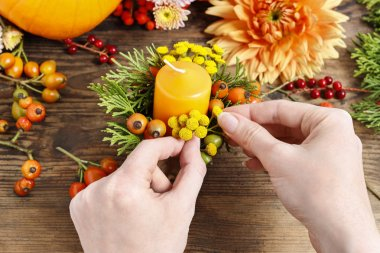 Florist at work. How to make autumn floral decorations. Tutorial