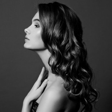 Beauty Model Girl with Long Healthy Wavy Hair and Perfect Makeup