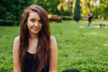 Brown hair girl  in the park
