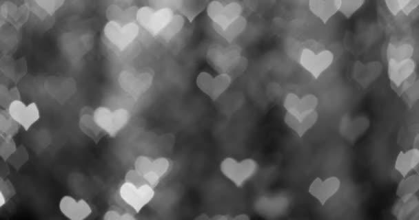 Gyönyörű bokeh könnyű elvont hatás. Valentin-nap animált keret a szív