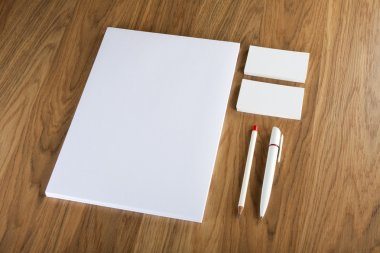Blank Stationery on wooden background. Consist of Business cards