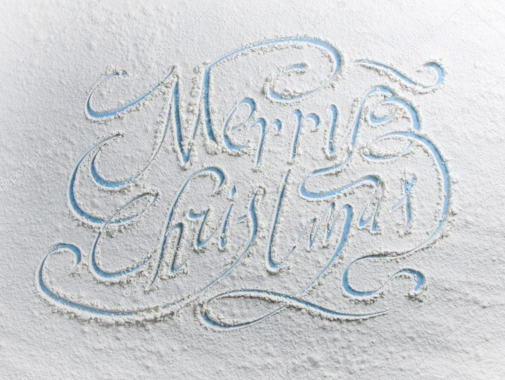 Written words Merry christmas on a snow.
