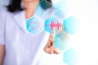 Nurse pressing cardio gram bottom show cardiology concept