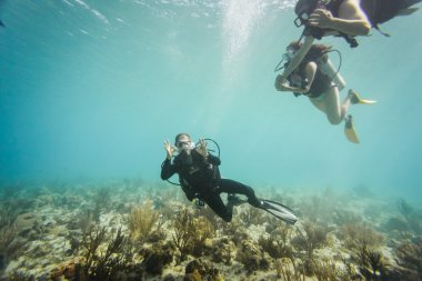 Scubadiver doing the okay sign underwater at San Andres Island,