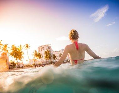 Woman at the Sea Enjoying the hot Water