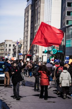 Protester Agitating a Red Flag in the Street