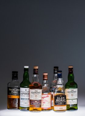October 1st - Montreal, Canada. Collection of a few Good and Popular Single Malt Scotch Bottles in studio. stock vector