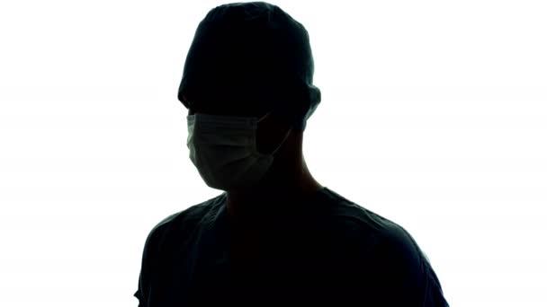 Doktor rotující s obličejovou maskou