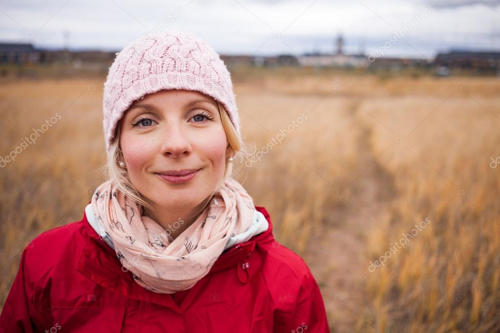Woman on a cold Autumn day  In a Field