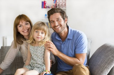 Family portrait in white living on sofa. Face camera stock vector