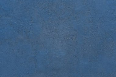 homogeneous coarse and rough texture plastered wall of blue color for background or wallpaper