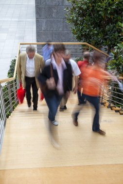 Office worker walking up stairs, motion blur