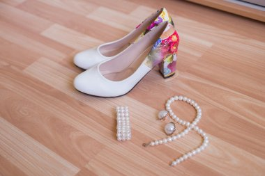 wedding shoes bracelet and earrings, a necklace