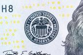 Fotografie Federal Reserve System-Symbol auf hundert Dollar Bill Closeup mac
